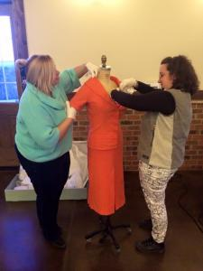 Deanna Brandenberger and Caitlin Dockery fit Ava's dress to the mannequin so that it bears her legendary hourglass measurements.