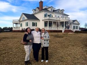 Caitlin Dockery, Deanna Brandenberger, Mary Helen Wyatt pose in front of Moore's Springs Manor, the venue for Ava's exclusive event!