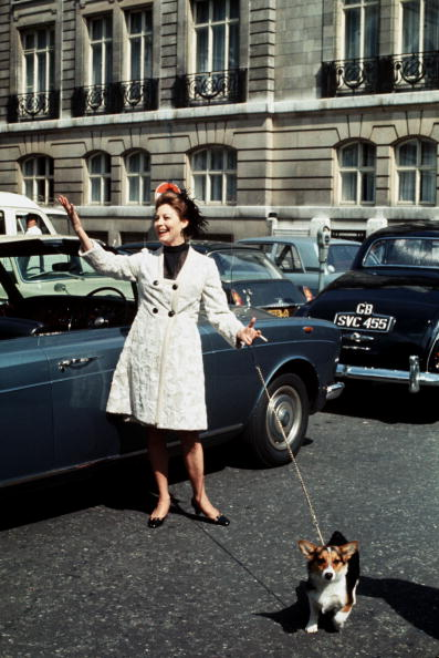 London, England, 1969, American actress Ava Gardner is pictured walking her pet dog while on location filming the movie