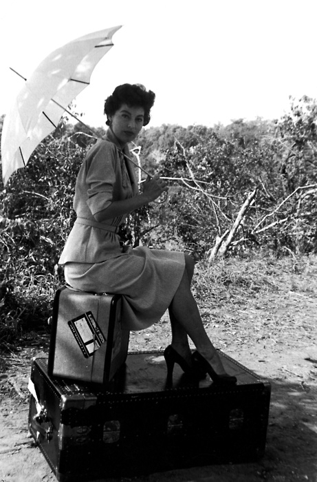 Ava with her suitcases on set of
