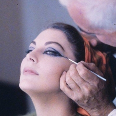 Ava having makeup applied on set of The Bible.